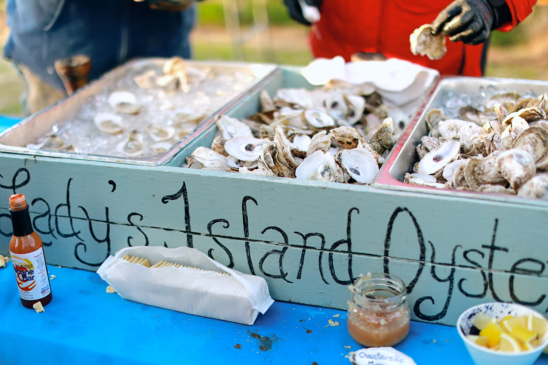 At Lowcountry oyster roasts you'll shuck the best oysters in Charleston South Carolina | WhereTraveler