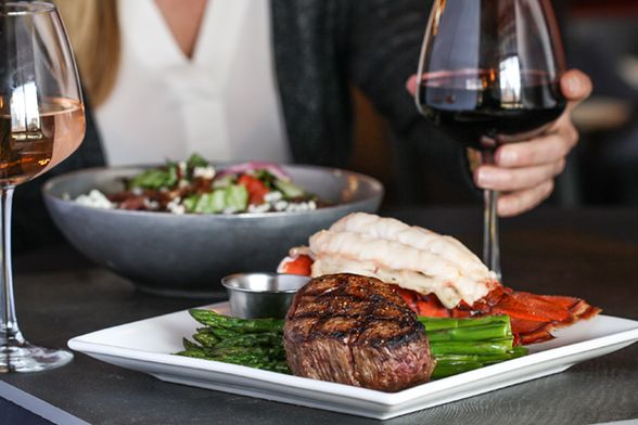 Try the prime steak at District ChopHouse | WhereTraveler