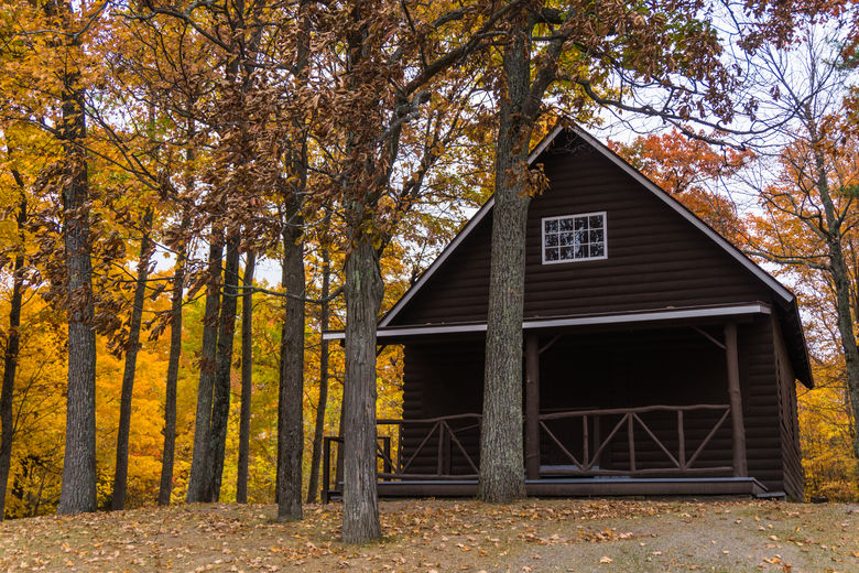 Cabin in the woods in the fall