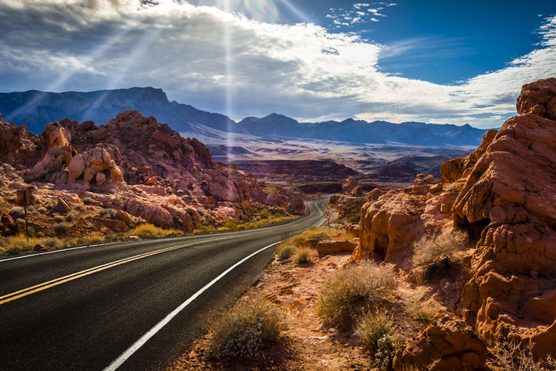 n the Valley of Fire State Park, it's all about color. The park is famous for its 40,000 acres of deep red Aztec sandstone outcroppings | WhereTraveler